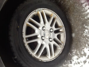 I HAVE 4  195 60 R 15 TIRES ON FORD FOCUS RIMS $200