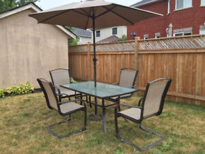 Patio table, 4chairs, stand and umbrella