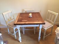 Extendable table with four chairs