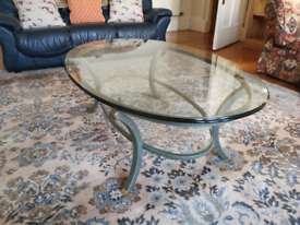 Glass topped oval coffee table