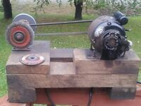 Vintage electric motor and bench grinder.