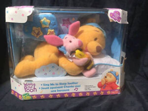 Winnie the Pooh nap & bedtime soother!Plays a tune, sings