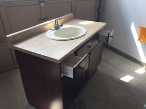 "1)	Good condition 48"" Vanity with sink and working faucet."