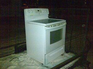 White five burner Kenmore glass top oven/stove