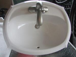 Bathroom sink with Moen Faucet