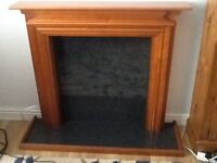 Wooden fire surround and hearth to match