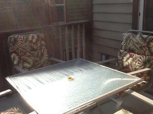 Patio set with 4 rocker chairs,cushions and table