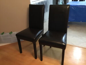 Two Modern brown faux leather dining chairs - like new!