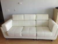 URGENT!! NEW LEATHER COUCH-BARGAIN PRICE!!