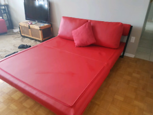 Funky red leather pull out  couch