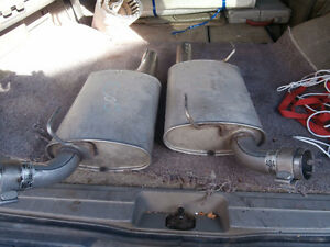 2 ford mufflers could be for a mustang 07 left by owner of hous