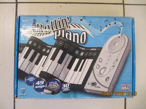 Compact Rollin Piano Touch Sensitive Mat49 keys 30functions New!