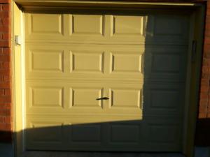 2 standard size 8x7 steel garage doors