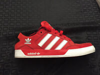 Pair of red Adidas low tops. Size 11.5