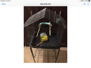 Roomy bird cage on rolling stand