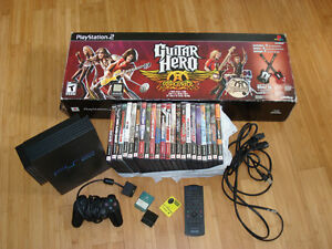 Sony PlayStation 2 with Guitar Hero and 22 games
