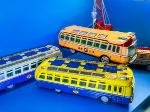 Tin Vintage Buses to go?  I am looking for!