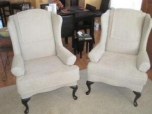 Two Matching Wing-Back Chairs and Matching Ottoman