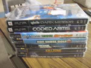 7 psp games 5 new and 2 used first $20 takes them great games