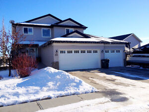 Triple Garage with RV Parking, backing onto a Park!