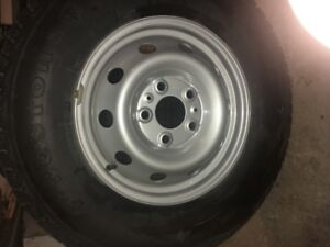Four studded winter tires on Ram Promaster rims. LT 225/75/16