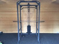 Power Cage with weight stack and barbell plates