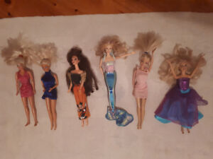Assorted Dolls and cloths including Barbie