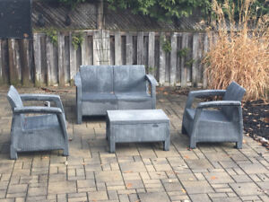 Outdoor faux wicker seating set