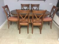 Oval extendable dark solid wood table with six chairs