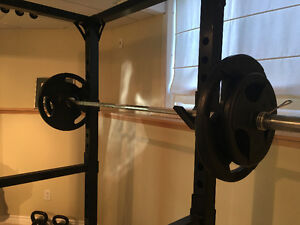 Olympic Bar and 275 lbs free weight.