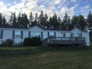 MINI HOME FOR SALE  WITH 18 ACRES  & BARN