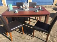DARK WOOD TABLE AND 4 CHAIRS FREE DELIVERY GOOD CONDITION