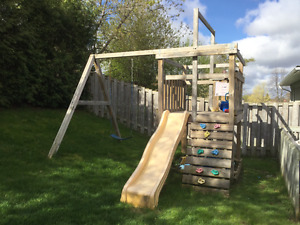 Wooden climber swing set and slide