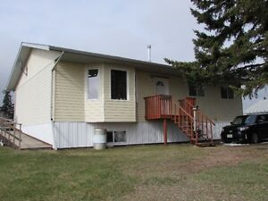 Newer bungalow at the edge of town on HUGE corner lot