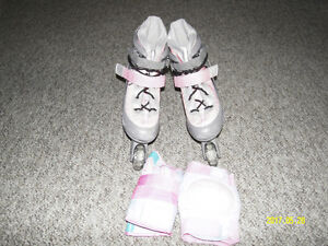 Girl roller blades pads included like new size 1.