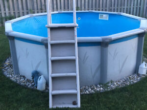 Pool, above ground 12x12 with safety ladder and sand filter
