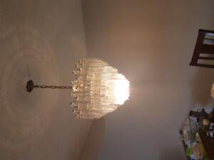 Hanging chandelier and matching hallway lights