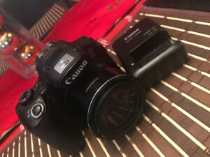 CANON POWERSHOT SX60 HS WITH BATTERY AND CHARGER $550.00
