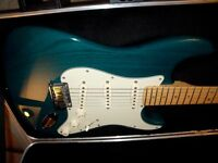 Fender American Strat Deluxe in Teal with Maple Neck. 2002 model