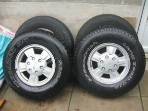 "CANYON / COLORADO STOCK 15"" RIMS C/W 235/75R15"" ALL SEASON TIRES"