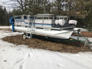 Pontoon booat and motor with trailer