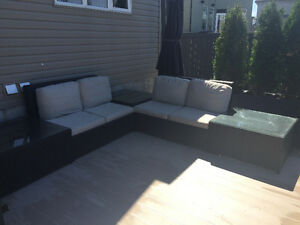 Black rattan patio sectional with glass table tops