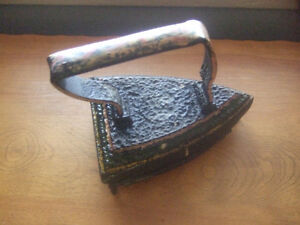 antique clothes iron with trivet