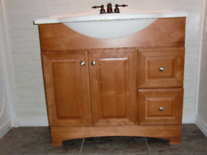 Bathroom vanity with sink and tap