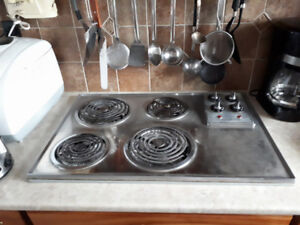 General Electric metal cook top stove is for sale $ 60.