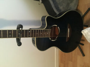 Guitar Yamaha  beautifull blue asking 300$ firms comes with stan