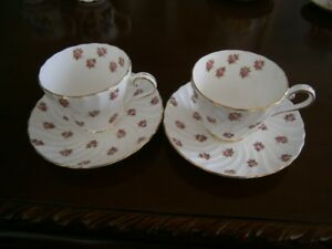 TWO PRETTY FLORAL AYNSLEY CUP AND SAUCER SETS