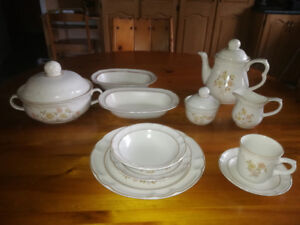 Dishes- setting for 16, matching serving and coffee/tea set
