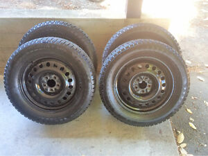 Almost New Studded Winter Tires and Rims (Ford Flex)