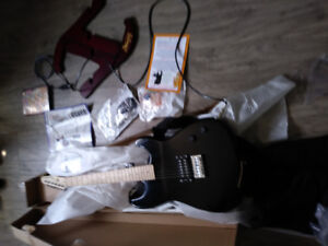 BRAND NEW GUITAR WITH STAND FOR SALE $125 It comes with bag and
